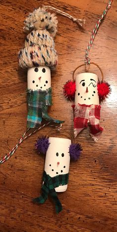 Fun, lovable and unique! These adorable snowman ornaments are made from recycled wine corks. Each one is hand painted and one of a kind. Perfect for any wine enthusiast, hostess gift, wine tag, holiday table decoration or just a unique way to say thank you. They are also perfect for