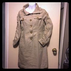 Michael Kors  Kaki long sleeves dress Has a small spot at right pocket as in picture. Has pockets made in dress. Buttons up 100% cotton . Michael Kors Dresses Long Sleeve