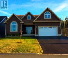 10 ATLANTICA Drive Paraidse Newfoundland (1122448)   Located in the executive subdivision of Island View Estates is the Beautiful Executive Bungalow with attached Garage and sits on an extra deep lot. From the moment you enter the home you experience the quality finishes and pride of ownership that you expect.  For more info contact Wally Lane (709) 764-3363 wally@normanlane.ca