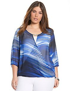 Sheer printed blouse works a graceful silhouette into your wardrobe with a draping surplice neckline and high-low hem. 3/4 sleeve blouse plays the flirt with hardware detailing and a keyhole back. Layer this breezy number over your favorite cami for a feminine combo.  lanebryant.com