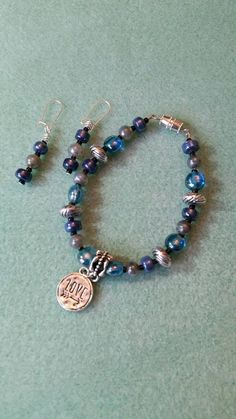 Check out this item in my Etsy shop https://www.etsy.com/listing/265155601/aqua-blue-love-pendant-beaded-bracelet