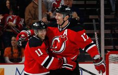 Ilya Kovalchuk #17 of the New Jersey Devils (R) celebrates a shorthanded goal at 17:18 of the first period against the Philadelphia Flyers along with Stephen Gionta #11 (L) at the Prudential Center on March 13, 2013 in Newark, New Jersey. (Photo by Bruce Bennett/Getty Images)