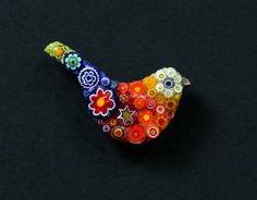 Beautiful handmade bird brooch with Italian melted glass beads. A statement piece which will turn heads with how cute it is #brooches #jewellery #womens #fashion #lillymosiac #bird #design