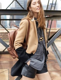 Madewell streetcar coat worn with quilted vest + leather zip shorts.