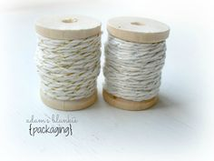 silver and gold shimmer twine on two adorable wooden spools.  the possibilities are endless! staple item you NEED! by adamsblankie, www.adamsblankie.com