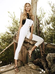 The ultimate summer street style staple: classic five pocket white overalls with a button-up front. Style this denim statement with a simple black top for a laid-back California look.