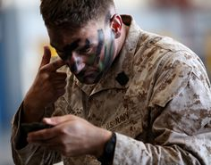 Petty Officer 2nd Class David Hess, corpsman from 3rd Battalion, 25th Marine Regiment, 4th Division, applies camouflage paint to his face July 29, 2010 at Camp Pendleton, Calif. Hess and Marines from Combined Anti-Armor Team, Company K, acted as a quick reaction force for training missions during the final week of 3rd battalion's training before deploying to Afghanistan.