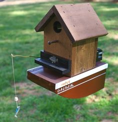 Ideal for the captain... or first mate! Fun boat birdhouse is handcrafted of…