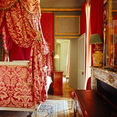 colorful red bedroom in French chateau ~ Jacques Garcia design