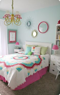 Fab Teen Girls Bedroom full of COLOR!! 320 Sycamore filled this room with teen spirit! This room is bright and full of life! Love the mirror collection on the wall.
