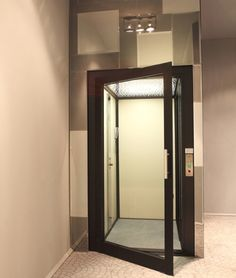 Residential elevator price home elevator system hydraulic for Home elevators direct