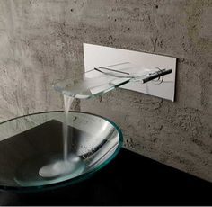 Basement bathroom glass faucet with glass sink with wall stone