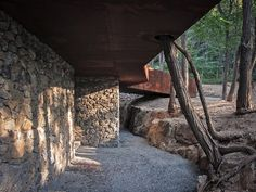 trace architecture office (TAO) has constructed a teahouse inside an abandoned quarry in china's shandong province.