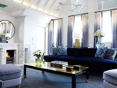 navy and gold living room. gold and black coffee table, navy sofa.