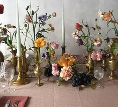 Floral tablescape of Spring flowers, brass vessels, fruits & tapered candles Wedding Centerpieces, Wedding Table, Wedding Decorations, Floral Wedding, Wedding Flowers, Table Flower Arrangements, Candle Sticks, Decoration Table, Bud Vases