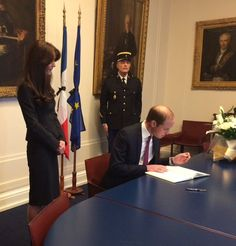 Signing the book of condolence for the victims of Paris attacks