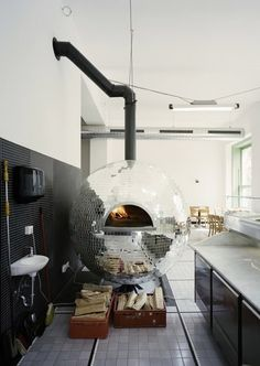 Basically killing two birds with one stone, a pizza oven in a giant disco ball, two things I want in my room for no reason