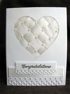 handmade wedding card ... white on white ... woven satin ribbon fills negative space die cut heart ... luv the little pearls on the crossings ...