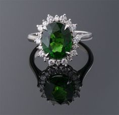 Oval Tsavorite Garnet and Diamond Ring  Platinum (16 x 14mm)  G=4.19cts + D=0.45cts  $30,000