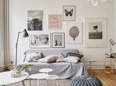 living room. soft hues. picture wall