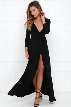 Stroll along tree-lined lanes, with a glass of ice tea and the Garden District Black Wrap Maxi Dress flowing in the breeze! Jersey knit wrap dress has a tying sash.