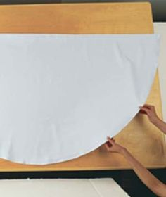 Head off wrinkles with this method of folding a round table cloth