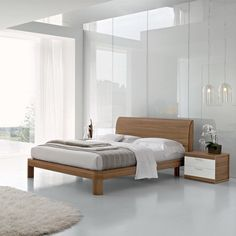 Lovely mid-century design with plenty of shine thanks to the glass panels and large windows. #simple #elegant #bedroom