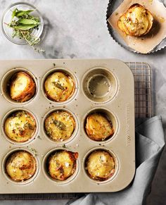 Parmesan and Herb Potato Stacks | Sliced potatoes are tossed with Parmesan cheese, fresh thyme and cream, then layered in muffin cups and baked until tender. A new take on gratin for Thanksgiving.