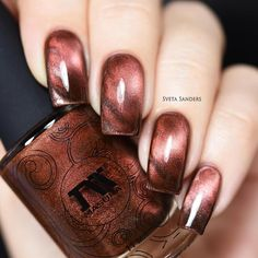 A stunningly unique brown-orange magnetic polish for stunning nail art. Collection: Silky Way Gorgeous nails by yagala, sveta_sanders, and glitterfingersss