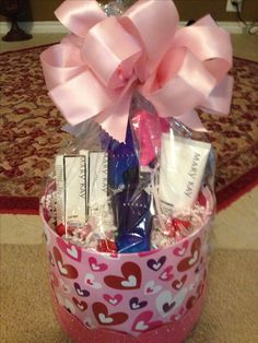 This is a beautiful pink, feminine basket featuring our Belara perfume, Satin Hands Lotion, and Satin Lips Mask & Lip Balm!  Topped off with some Hershey Kisses