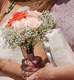 Bridesmaid bouquet is the opposite compliment in colours to the brides