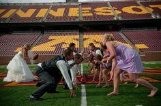 Wedding photo on the 50 yard line of TCF Bank Stadium. Jealous.