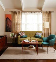 In love with this midcentury modern living room. That chair! Love it. via: http://www.bhg.com/decorating/color/schemes/living-room-color-schemes/#page=8