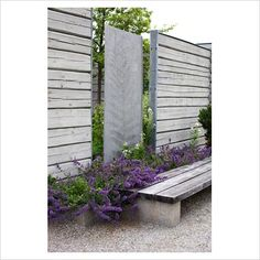 Privacy wall and bench made of wood, concrete and steel--contemporary