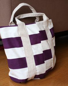 Last year I made a striped beach tote and this year I found some perfect purple striped canvas weight fabric at my local fabric outlet for only $4 a yard and knew I wanted to make another version.  Would you like to learn how to make one too? Okay! Keep reading! 1. Cut two pieces …