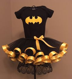 BatGirl Costume, Black Onesie/Shirt with Yellow Bat Symbol and Black/Yellow Tutu Outfit For Baby/Toddler/Girls by cutepinkruffles on Etsy https://www.etsy.com/listing/555398545/batgirl-costume-black-onesieshirt-with