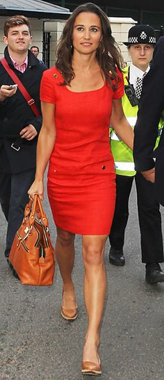Pippa Middleton stepped out wearing a red dress to attend Wimbledon in England. The linen shift with a square neckline and gold buttons is part of the NW3 by Hobbs collection.