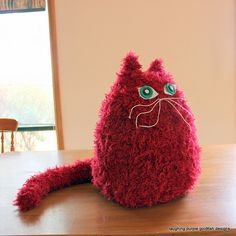 This cuddly oversized cat is worked up using large needles and chunky yarn.  You could place a weight in the base and put him to use as a door stop. He sits 45cm tall - that's a whopping 18 inches! This PDF Knitting Pattern is available for AU$4.50 at http://laughingpurplegoldfish.blogspot.com/