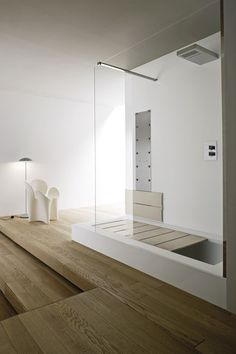 Its a full sized shower that converts into a full sized sunken tub with a reading platform. :)