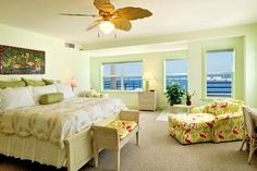 Luxurious bedroom enjoys window views of the water on two sides and it's own en-suite bathroom. Private Key West Sunset | 3 Bedroom Nightly Vacation Rental
