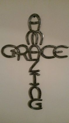 Amazing Grace cross made out of horseshoes