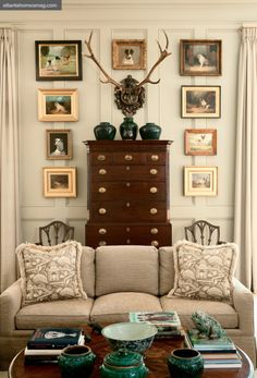 In the family room, a mix of 18th- and 19th-century dog paintings frames an exquisite highboy. The room's paint color is Studio Taupe by Sherwin Williams.