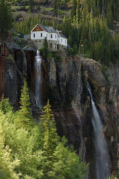 Bridal Veil Falls is the highest cascade waterfall in Colorado.  This  house used to be the Smuggler-Union Hydroelectric Power Plant, which  provided electricity to the town of Telluride.  It is now a private  residence.