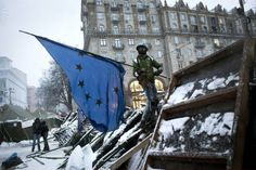 Dec. 9, 2013. Taras, 18, an anti-government protester stand guard and raises an EU flag, a symbol of the protest movement, at one of the barricades defending Maidan Square against police and government supporters in Kiev, Ukraine. (Photo: Etienne de Malglaive/Getty Images)  Read more: Pictures of the Week: December 6 – December 13 - LightBox http://lightbox.time.com/2013/12/13/pictures-of-the-week-december-6-december-13/#ixzz2nOgkQpEM