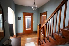 Love the front door! Stratton Blue with wood trim Benjamin Moore