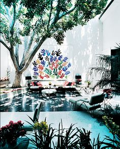 Would have never thought to use Matisse art outdoors. So cool with the live trees.