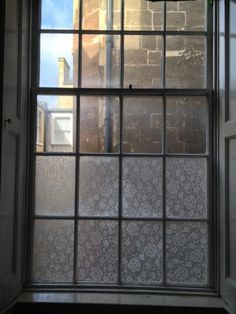Lace cornstarch window treatment --using lace, cornstarch, water and a paint brush you can create beautiful windows. I am even going to try using the lace as a stencil for glass etching (on a scrap piece of glass first)