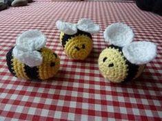 Cute Little Bees  http://yellowpinkandsparkly.blogspot.com/2009/09/fuzzy-little-friends.html