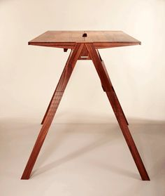 A German Standing Desk Ups Office Ergonomics and Aesthetics by Björn Kersting, wsj: Desk envy. The height of the Crescendo C2 Maximus M22 can be adjusted by adding and removing segments of the desk's legs. Each segment is numbered to ensure the wood grain will appear continuous. #Furniture #Desk #Standing_Desk