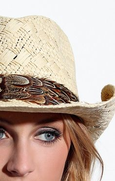 The Beige Cowboy Hat features feathers around rim of hat. $120.00